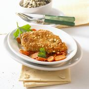 Breaded chicken breast with peanuts and carrots Stock Photos