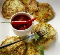 Courgette pancakes with tomato salsa Stock Photos