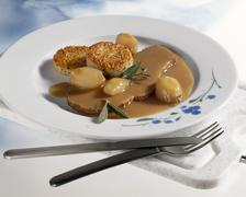 Braised loin of veal with rice cakes Stock Photos