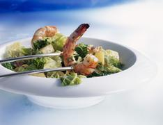 Savoy cabbage with potatoes and prawns Stock Photos