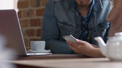 Girl uses the phone in cafe. 4K 30fps ProRes (HQ) Stock Footage