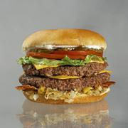 Double Cheeseburger with Bacon, Lettuce, Tomato and Pickles Stock Photos