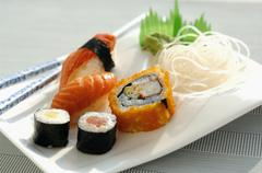 Assorted sushi on a plate with radish Stock Photos