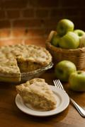Slice of Homemade Apple Pie; Whole Pie in Background Stock Photos