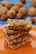 A few bars of nut brittle on orange plate Stock Photos