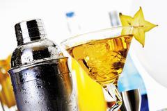 Cocktail and various bar utensils Stock Photos