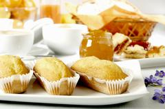 Baked goods, jam and cappuccino for breakfast Stock Photos