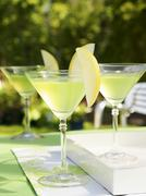 Apple Martinis on table out of doors Stock Photos