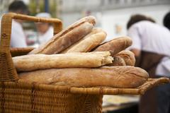 Basket of Artisan Bread at Market Stock Photos