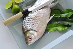 Dace with limes (Freshwater fish, Thailand) Stock Photos