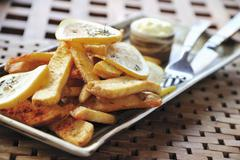 Country potatoes with lemon slices Stock Photos
