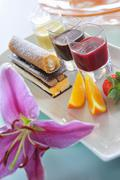 Chocolate and mousse confection with various fruit sauces Stock Photos