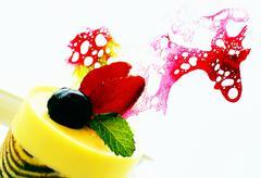 Mango confection with caramel decoration Stock Photos