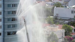 Fire fighting in high rise building: rescue workers move up on plug Stock Footage