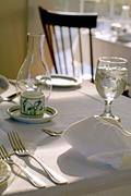 Table Set with White Linens and Ice Water Stock Photos