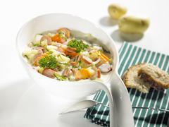 Colourful vegetable stew with sausages Stock Photos