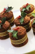 Chocolate cakes with marzipan holly Stock Photos