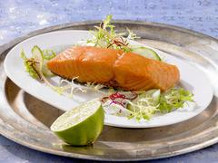Smoked salmon with a salad garnish Stock Photos