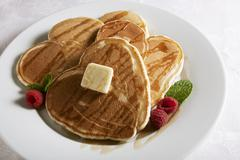 Heart Shaped Pancakes with Maple Syrup and Butter; Raspberry Garnish Stock Photos
