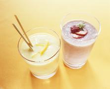 Mango yoghurt drink with mineral water & strawberry buttermilk Stock Photos