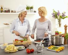 Hobby cooks cooking a meal Stock Photos