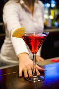 Bartender Serving Cosmopolitan Kuvituskuvat