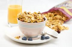 Gluten Free Granola in a Bowl with Blueberries; OJ and Bag of Granola Stock Photos