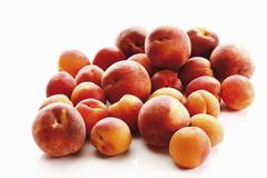 Fresh apricots and peaches Stock Photos