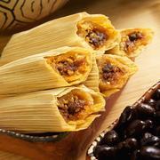 Mini Beef Tamales in Corn Husks; Black Beans Stock Photos