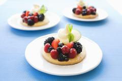 Shortbread with berries and icing sugar Stock Photos