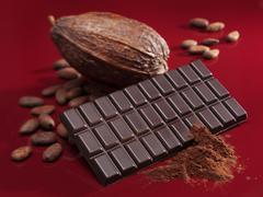 Bar of chocolate, cocoa powder, cacao fruit and cocoa beans Stock Photos