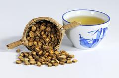 Saposhnikovia root in tea strainer, bowl of tea Kuvituskuvat