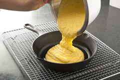Pouring Corn Bread Batter into a Cast Iron Skillet Stock Photos