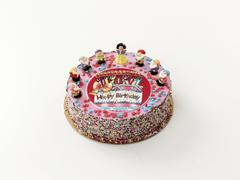 A birthday cake decorated with fairytale figures Stock Photos
