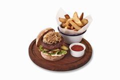Hamburger with ketchup and chips Stock Photos