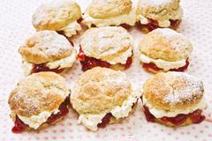 Nine scones with raspberry jam and cream Stock Photos