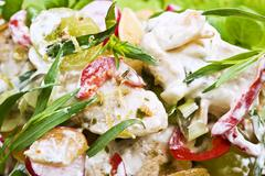 Chicken salad with a creme fraiche dressing, tarragon, grapes and chilli Stock Photos