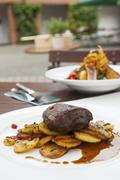 Rump steak with fried potatoes Stock Photos