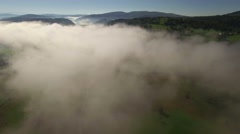 Aerial: slow flight over the road under the clouds towards Uvac lake, Serbia. Stock Footage