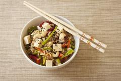 Asian Rice with Vegetables, Tofu, Sesame Seeds and Cashews; Chopsticks Stock Photos
