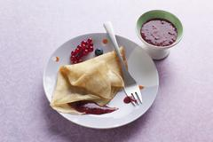 Crepes with berry sauce Stock Photos