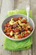 Gnocchi with chorizo, kidney beans and cherry tomatoes Stock Photos