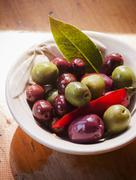 Bowl of Mixed Olives with a Chili Pepper and Bay Leaf Stock Photos