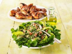 Tabbouleh and grilled chicken legs Stock Photos