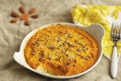 Carrot gratin with sunflower seeds Stock Photos