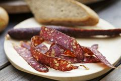 Supper with venison salami Stock Photos