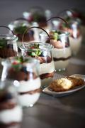 White and dark chocolate mousse in dessert glasses Stock Photos