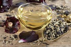 Hollyhocks: tea and petals Stock Photos