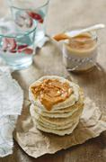 Peanut and chilli sauce in a jar and on unleavened bread Stock Photos