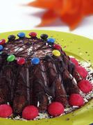 A chocolate caramel cake decorated with chocolate beans Stock Photos